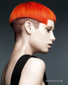 2012-orange-shaved-sides-short-womens-hairstyle.jpg-pin it by carden