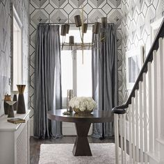 #Hallway can help you best, when you plan a party in a small space. Use white and silver wall paint for an #elegant look. Big size #uPVC doors with curtains, which can be drawn across the door in winters.