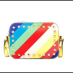"Steve Madden Rainbow Studded Crossbody Bag Coming Soon, please leave a message if you want to be notified when it it's available for purchase this week Beyond cute, and very unique! Big enough to fit your ""must haves,"" small enough to not be a burden! All of the Steve Madden bags I sell are very unique, hard to find, and usually sold out! Get this while you can....... Price Firm, but will take off shipping charges. Steve Madden Bags Crossbody Bags"