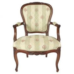 "Vintage French oak wood parlor chair with floral upholstery and carved detailing.  Product: ChairConstruction Material: Oak and poly blend Color: Brown and multiFeatures: Hand-carved detailingDimensions: 37"" H x 24"" W x 23"" DNote: Due to the vintage nature of this product, some wear and tear is to be expected. Products may show signs of brand marks, scrapes or other blemishes."