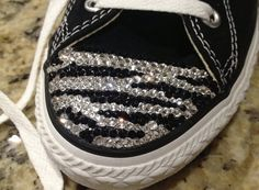These are hand blinged Converse shoes with Swarovski crystals. These shoes are perfect for teens and adults to show their wild side with their