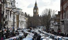 Thousands of London's traditional black taxis bring the streets around Westminster to a standstill during a protest against car-sharing service Uber and government pressure on their regulatory body on Wednesday