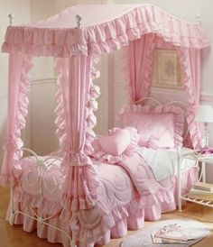 This is exactly like my bed when I was little.  My pink bed clothes were eyelet though.  It was beautiful.  :)
