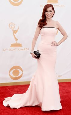 Carrie Preston in Romona Keveza. It's a pretty dress but with her hair and skin color it washes her out (not to mention her hair matches the carpet and her dress matches the backdrop)