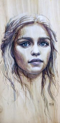 'Portrait of Daenerys, by Fay Helfer. The method is called pyrography, the art of writing with fire: the artist uses a heated point to decorate wood or other materials.'