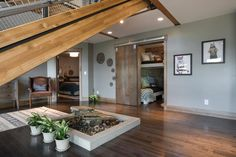 """An indoor water feature delivers a zen-like vibe to the lower level with a smooth indoor-outdoor transition. """"It's high desert here, the humidity is really low so I wanted to have a water feature in here partly for the indoor air humidity as well as just the general ambience,"""" says Dylan."""