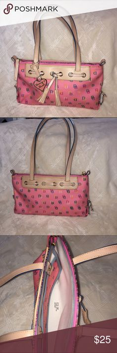 Pink Dooney and Bourke purse Pink Dooney and Bourke purse. Two straps. Two pockets inside. Zipper closure. Dooney & Bourke Bags Shoulder Bags