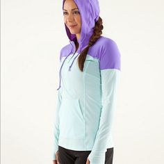 """Lululemon Runbeam Hooded Pullover Lightweight hooded pullover. 1/2 front zip with pouch pocket. Drawstring hood. Thumbholes at wrist. 17.5"""" across bust. 25"""" length. No size tag. Please use measurements for sizing. I do not know the size number and am estimating the size as a 6/8. Small spot on left front. Barely visible. See last photo. lululemon athletica Other"""