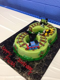 Three Thomas the Train - Used two 8 inch rounds covered in smoothed buttercream with fondant accents