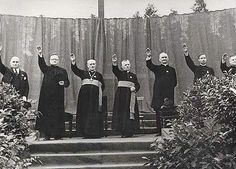 Catholic priests give the Nazi salute near the Vilna ghetto in occupied Poland. It should be noted that the priests gave the salute voluntarily and with enthusiasm. They did not speak out against Hitler who was a good Catholic until his death. Babylon The Great, Athiest, Catholic Priest, Roman Catholic, Anti Religion, Halloween Party Costumes, Jehovah's Witnesses, Saturday Night Live, World War