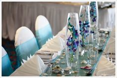 My colors are dark purple and aqua blue so these wedding table centerpiece would work perfectly for my beach wedding.