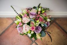 Lilac and wild roses for this round #BridalBouquet