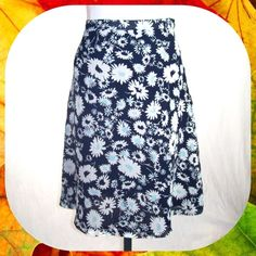 Navy Blue Floral Chiffon Overlay Skirt Size 12 / L Super cute A-line skirt with textured chiffon overlay. Dainty white floral print on a navy blue background. Navy lining. Above the knee. Size 12 or Large. Looks Like New! Jaclyn Smith Skirts A-Line or Full
