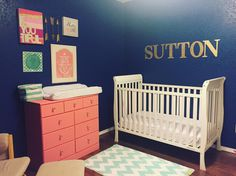 Navy, gold, coral and mint nursery