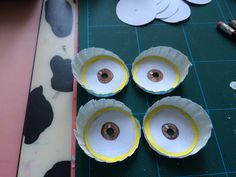 Step 04: Drawn eyes stuck into cupcake liner bases and holes punched to see out of