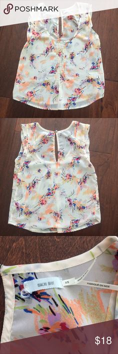 Kimchi blue for urban outfitters blouse! Kimchi blue for urban outfitters tan sheer floral print sleeveless blouse. Size XS. Pre loved but in excellent condition! Pit to pit is 16 in. Length is 21 in. A little on the cropped side and looks cute with high waisted jeans or shorts! Bundle and save! Urban Outfitters Tops Blouses