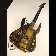 Fascinating steampunk styled guitar from Tony Cochan Guitars. Just saw this Boostercaster at the Richmond Science Museum as part of the National Guitar Museums traveling guitar exhibit. Guitar Chord Chart, Guitar Chords, Guitar Case, Steampunk Guitar, Guitar Kits, Custom Electric Guitars, Guitars For Sale, Cigar Box Guitar, Steampunk Design