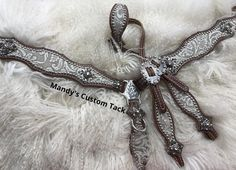 Mandy's Custom Tack silver/cream floral hide with white/clear crystal conchos