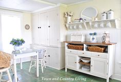 Creating Cozy Country Style on a Budget The built-in cabinet stores dishes and dry goods while a white sideboard purchased from a co-worker for $100 creates additional storage. The table and chairs were a flea market find for $75.