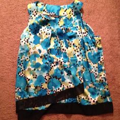 Colorful blue great summer top Great. Only worn once. Colors: black dots and strip on bottom, blue white and green Tops