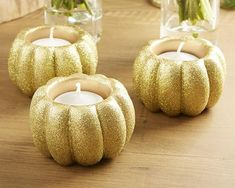 Perfect for including in fall wedding or bridal shower centerpieces or decorating the Thanksgiving table, these gold glitter pumpkin votive holders bring a touch of fall sparkle to your decor. This pu More