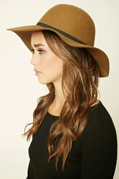 A floppy wool hat with a round crown and a skinny contrast grosgrain ribbon band.