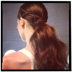 """marchesa-spring 2013-hair""Here's a superpretty ponytail from the Marchesa show. Inspired by India in the '60s, it's a center part with two crisscrossing braids on the side and a dry, textured look in the back. Doesn't it make you want long hair again?"