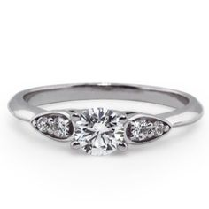 These accents are cool and unique without being overwhelmingly complicated.  Custom Classic Diamond Ring with Accents
