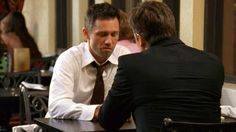 """""""I work for a bodyguard company. It's a joke. How about you?"""" [Brad the alcoholic bodyguard aka Michael]  """"Well, it's not too far from your line of work. I do security testing."""" [Lesher]   Pictured: Michael Westen (Jeffrey Donovan) and Lesher (John Allen Nelson)"""