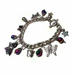 SALE Opulent Butterfly Charm Bracelet w/Various Beautiful Butterflies, Prism Rainbow Teardrops, Rhinestone Gemstone Star Charm FREE SHIPPING - Only $7.95 on Etsy! https://www.etsy.com/listing/229286766/sale-opulent-butterfly-charm-bracelet