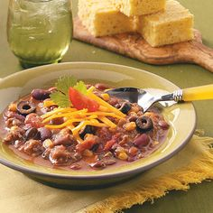 Three-Bean Taco Chili Recipe -This hearty chili is filling, nourishing and tastes like it simmered all day long. Leftover chili freezes well for a later time, so why not make a double recipe? To freeze: Cool remaining chili and transfer to freezer containers. Cover and freeze for up to 3 months. To use frozen chili: Thaw in the refrigerator. Place in a saucepan and heat through. —Wanda Lee, Hemet, California