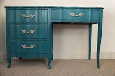 Painted in Peacock Tail by Behr  Inside of the drawers painted in Opulent by Behr  Hardware is original