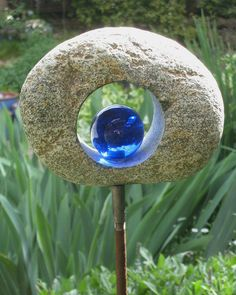 Garden Sculpture >> Eye-catching garden ornament - by gardenchien on Flickr.  Some beaches have stones with natural holes in them; these would probably look great too.