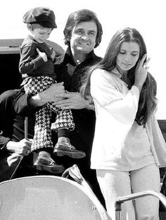 Johnny and June Carter Cash with their son John in 1973.