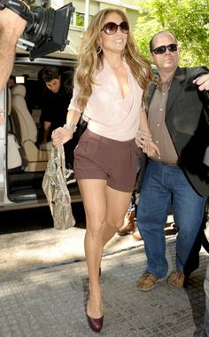 Everyone knows that J. Lo always looks fabber than fab everywhere she goes, but did you know that now you can get in on the action? She is wearing a blouse and shorts from her collection for Kohl's, as well as Brian Atwood pumps and Hermès jewelry.