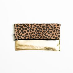 """Gold&Cheetah-Print 2-in-1 Foldover Clutch ‼️Don't buy this listing, I will make you one. Don't ask if you aren't planning to buy that day.‼️  So chic! All photos are my own. Made exclusively to be sold here.  • Unfolded:12""""x12"""" • 1:Gold; 2:Cheetah print • Cheetah:Textile; Gold:Faux-Leather • Gold has a tarnished look; Textile is slightly furry • 1 Zipper compartment inside • No tags, retail packaging  • Due to lighting, color of item in person may slightly vary from the photos  • PRICE IS…"""