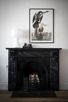 Impressive turn of the century home - COCO LAPINE DESIGNCOCO LAPINE DESIGN Black Fireplace Surround, Fireplace Surrounds, Fireplace Design, Natural Stone Fireplaces, Marble Fireplaces, Living Room With Fireplace, Living Room Decor, First Apartment Decorating, Design Blog