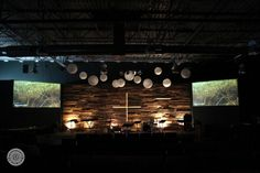 Church altar with floating lights, pallet walk and 2 screens Pallet Backdrop, Wall Backdrops, Youth Rooms, Youth Ministry, Floating Lights, Church Stage Design, Sound Absorption, Palette, Diy Pallet Furniture