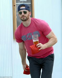 Good disguise: Chris Evans looked almost unrecognisable in his cap and shades as he treate...