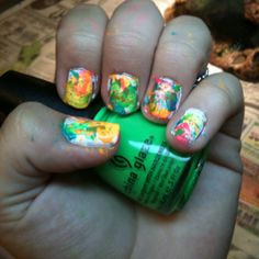 Splatter Nails  -Start with a base coat. I used white.  -surround your nails with tape for easier clean up -Put 5-7 drops of 2-4 polishes in different puddles  -Dip a straw in the color and blow briskly onto the nail  -Repeat with all colors.