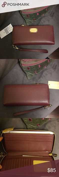 Michael Kors Wallet NWT MK Jet Set Item Travel Continental wallet. The strap is detachable. The color is Merlot with gold hardware. Inside has 16 card slots, space for a visible ID, pockets, space for cash, and a zip compartment for change. No holds or trades. Michael Kors Bags Wallets