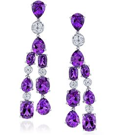 Amethyst & Diamond Drop Earrings  Pear and oval-shaped amethysts alternate with round brilliant-cut diamonds, in 18-karat white gold. Amethyst weight: approximately 11.69 carats total; Diamond weight: approximately 0.46 carats total.    Cellini Jewelers