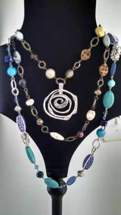 Beautiful beachy blues layered with fall browns. PD's Wild at Heart necklace doubled, enhanced with Silver Swirl enhancer and framed with Blue Lagoon necklace