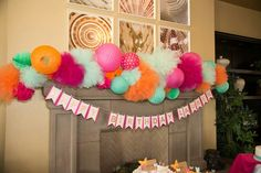 Tulle, pompom, lantern, and honeycomb mantle piece
