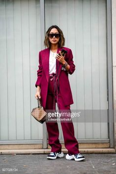 Aimee Song wears sunglasses a purple suit and blazer jacket a white top a Vuitton bag sneakers shoes during Paris Fashion Week Womenswear Fall/Winter...
