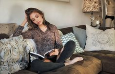 So cozy - couch, pillows, leggings, and sweater NECESSARY CLOTHING