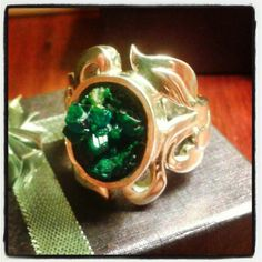 Dioptase crystal and silver ring I had made.....please can anyone give me some feedback about what they think about it?