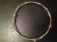 Guitar strings with metal tubes & beads