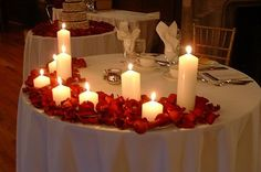 We discused something simple for the Sweetheart table - perhaps rose petals surrounding and different heights of floating candles (lower in the front as to not block your faces). Winter Wedding Decorations, Reception Decorations, Event Decor, Wedding Centerpieces, Decor Wedding, Wedding Ideas, Romantic Dinner Setting, Romantic Dinners, Romantic Mood