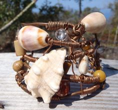 Water and Wind inspired Large Copper, Sea Shell Bracelet. Shells found at a remote beach in South Kona Hawaii, Copper from an Electric Job and made with Aloha.  I  truck down a 4x4 road for 6 miles to get to this remote beach, camp out  and shell hunt. I then bring my shell treasures home and start the  careful shell drilling. Handmade by Carmen